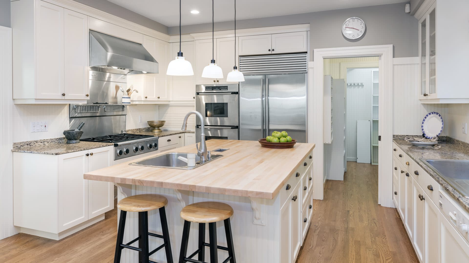 Luxury Kitchen Interior in white with wooden floor and kitchen i